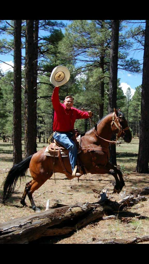 Patient riding a horse after recovering from oral cancer treatment by periodontist in Chandler, AZ.