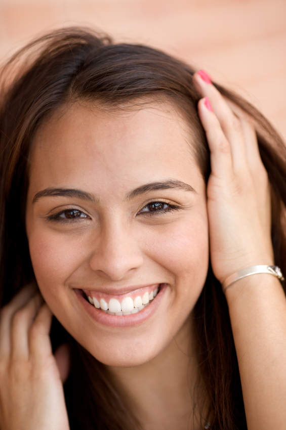 Hispanic woman smiling with hand in hair Scholes Perio