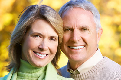 Older couple smiling about All on 4 treatment concept received in Chandler, AZ.